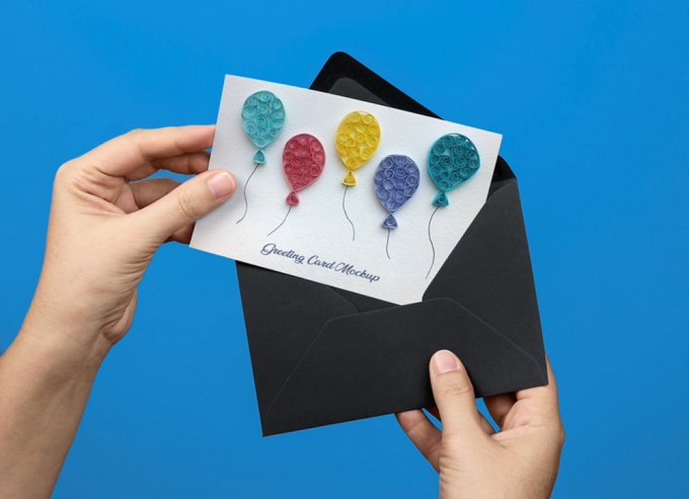 Free Hand Holding Greeting Card PSD Mockup