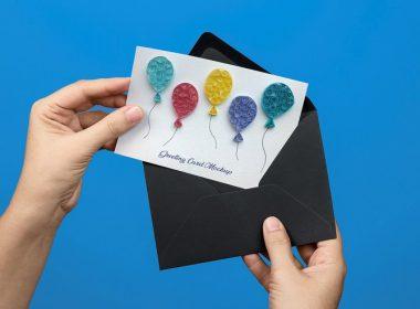 Free Hand Holding Greeting Card PSD Mockup