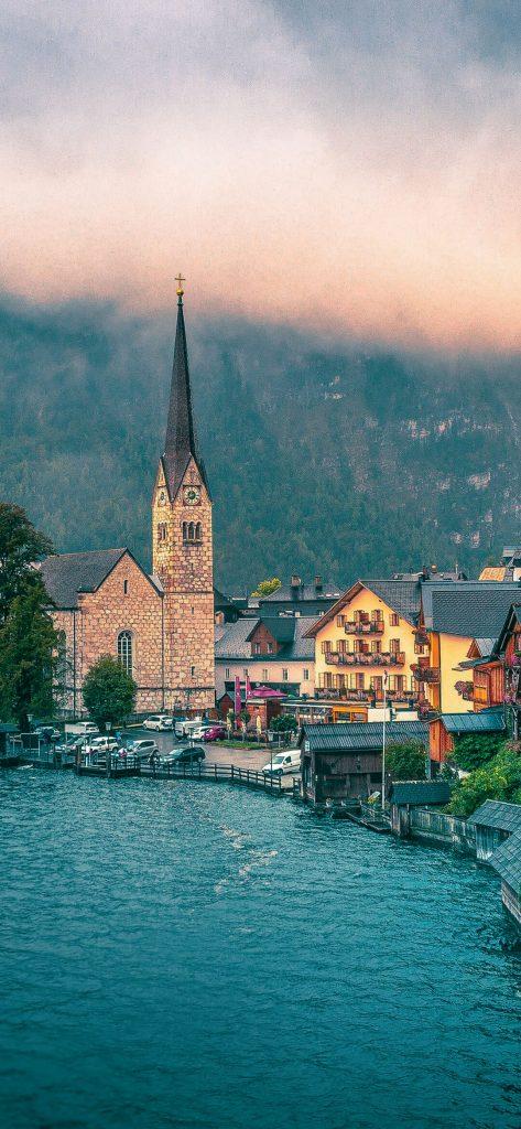 beautiful-church-near-mountain-wallpaper-1080x2340