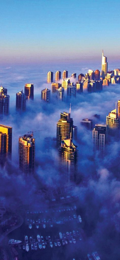 buildings-surrounded-by-clouds-wallpaper-1080x2340