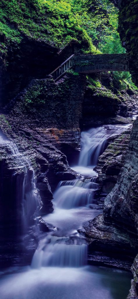small-waterfall-near-cave-wallpaper-1080x2340