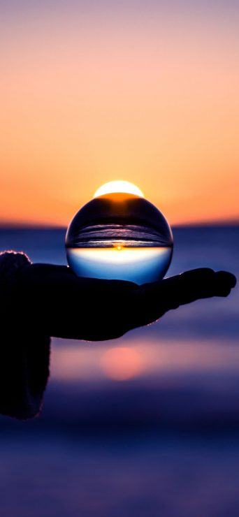 Sunset Through Glass Ball Wallpaper - [1080×2340]